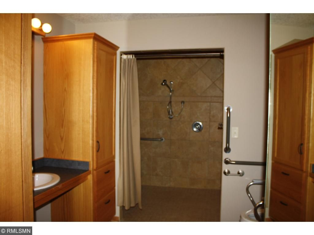 Roll in shower and raised commode.