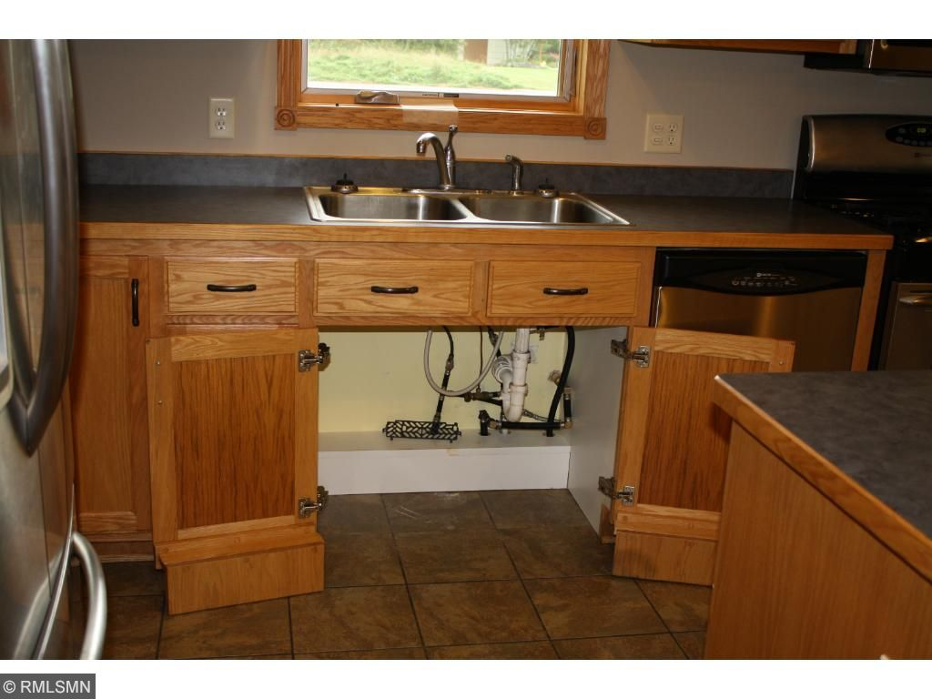 Kitchen and bathroom sink are roll under.