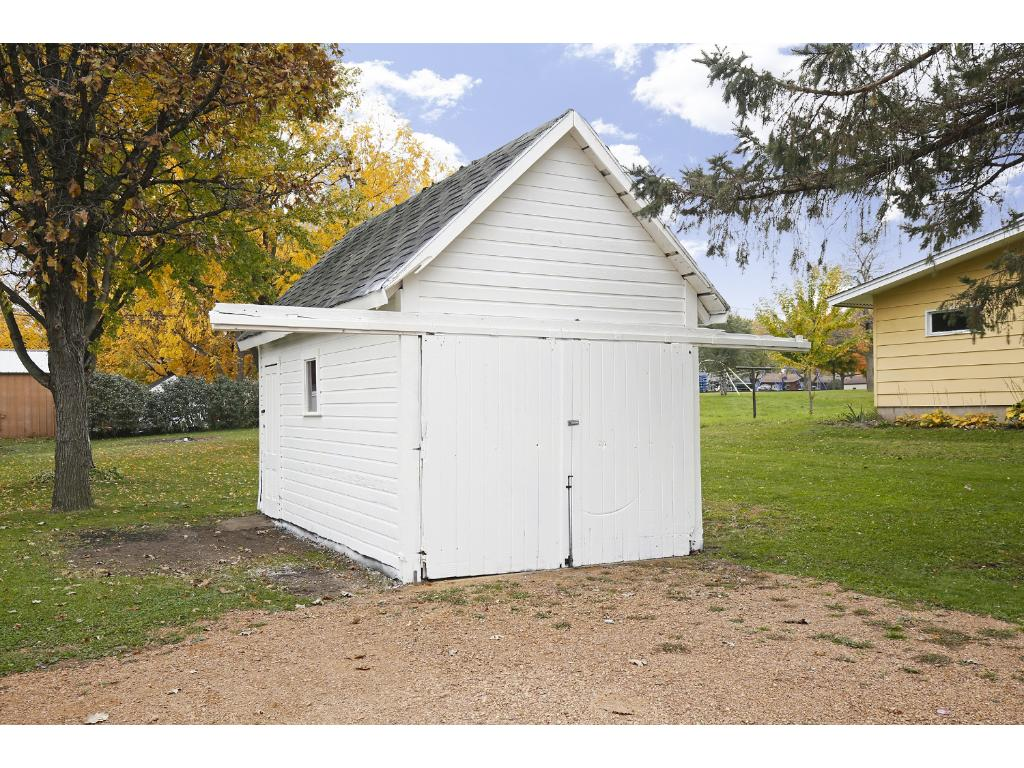Separate garden shed for seasonal equipment and bikes.