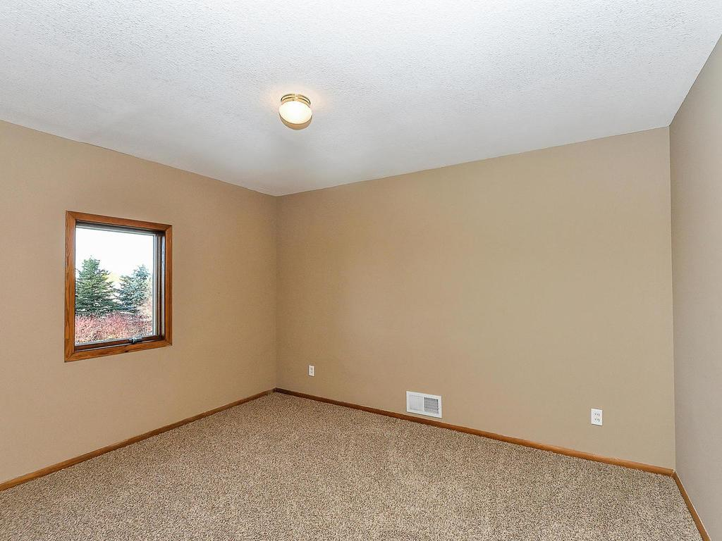 Three bedrooms on main level each with new carpet and paint.