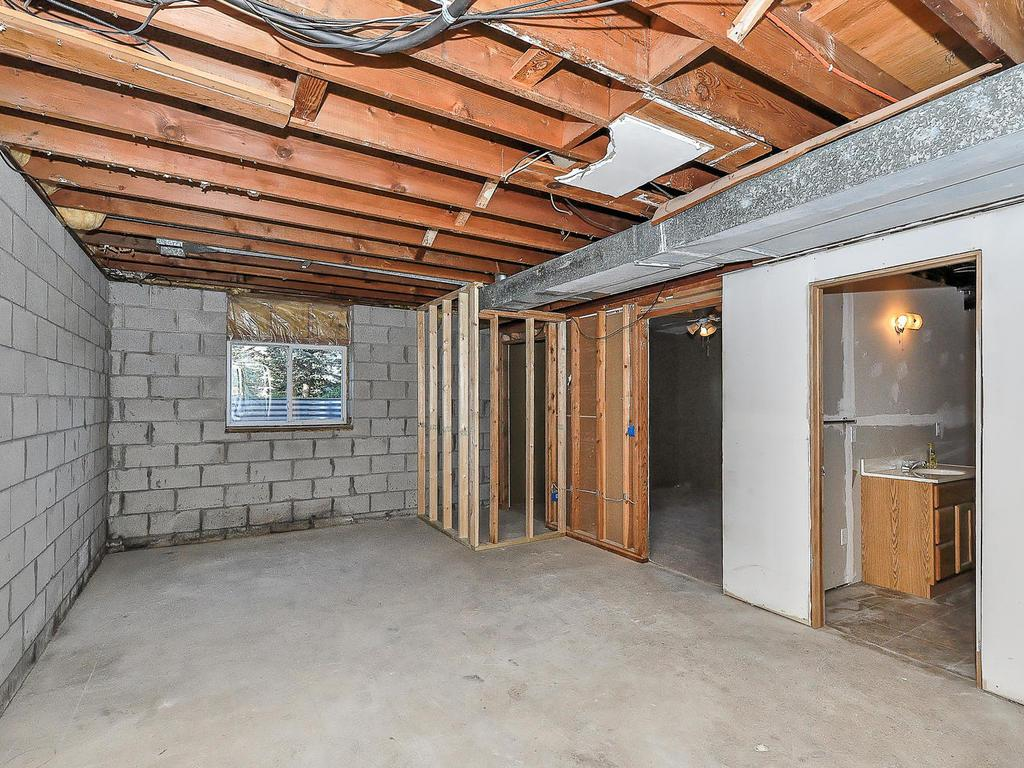 Build equity in lower level with potential for two rooms and added family space!