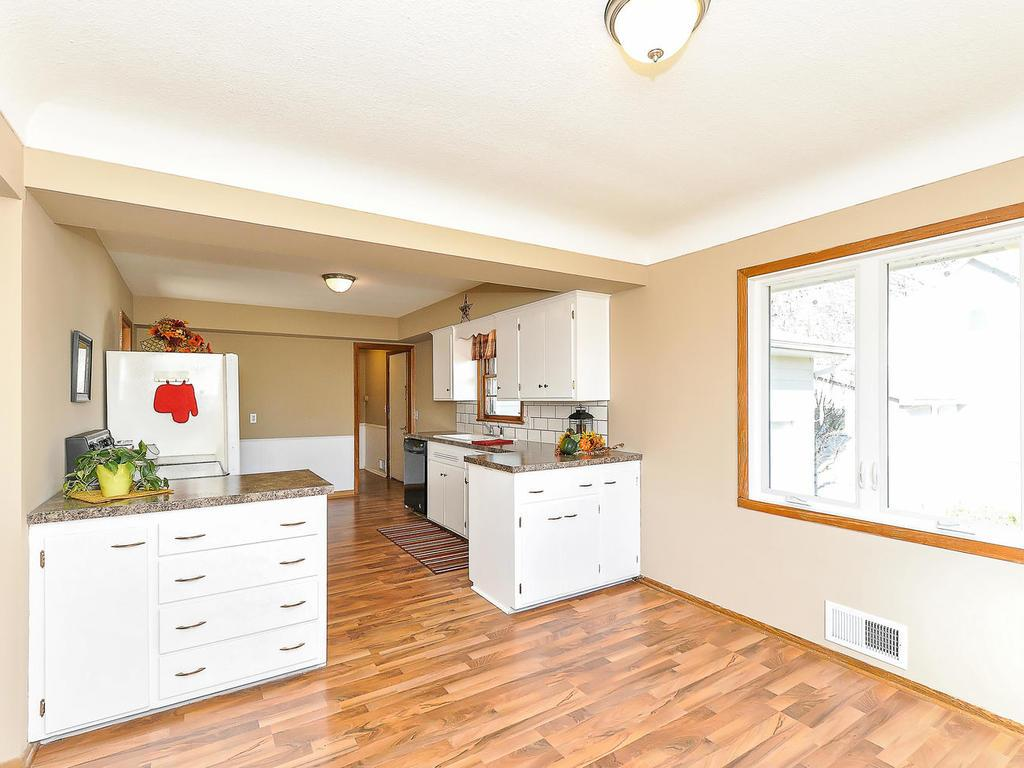 Updated spacious kitchen with eat in area plus adjacent dining area.