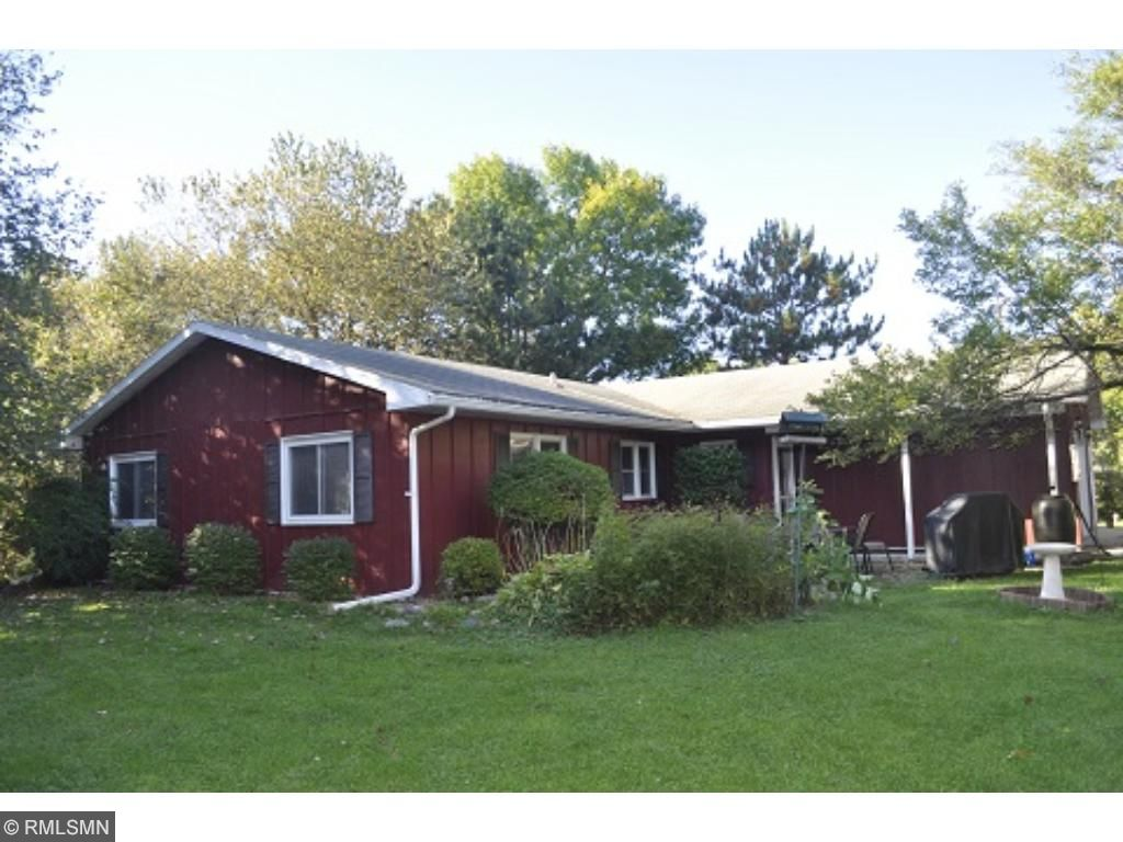 Adorable home on a +/- 1.5 Acre wooded lot on North Center Lake!