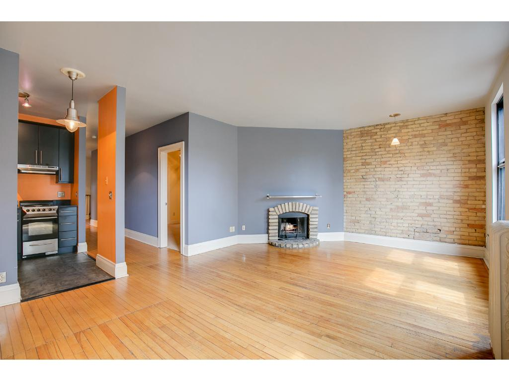 Calming colors in the paint, wood, and brick makes this condo a 10!