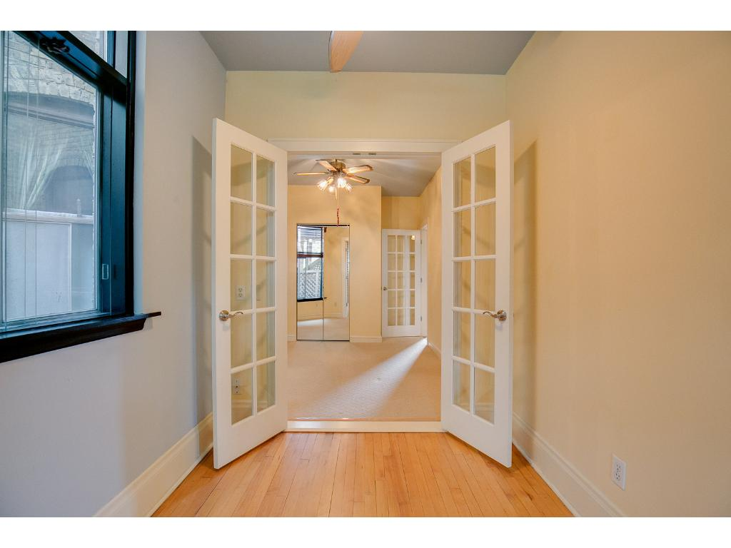 Incredible french doors give the this newly remodeled condo an updated look while still keeping the character