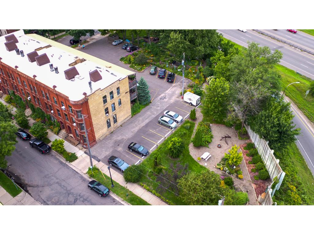 Aerial of the relaxing garden filled with beautiful flowers and sidewalks for the residents