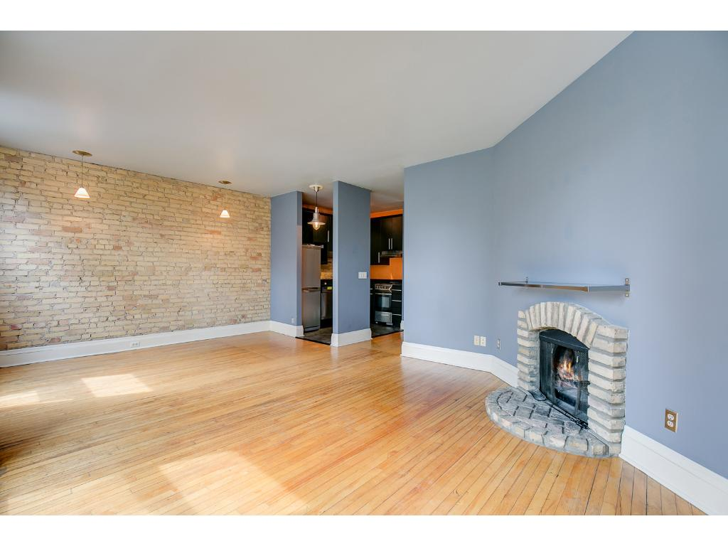 Beautiful stone fireplace adds an extra touch of class