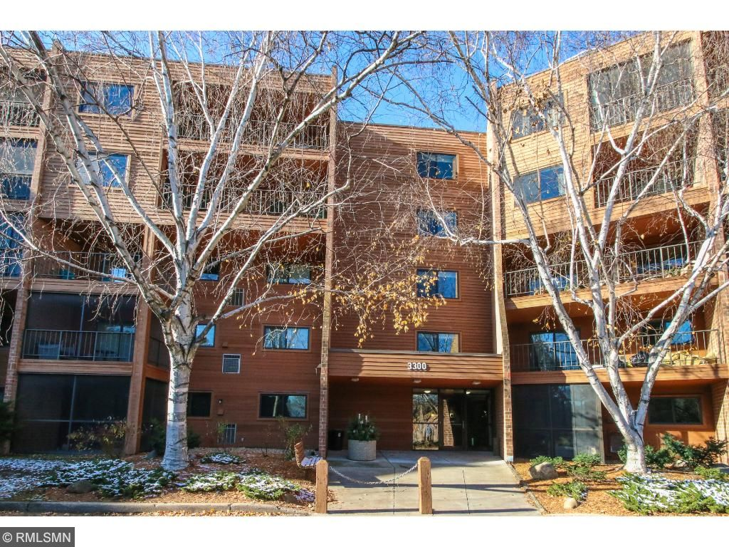 A secured entry welcomes you to unit #216 with heated parking. This unit has newer furnace, air conditioner, washer, dryer, refrigerator and oven.  Move-in Ready!