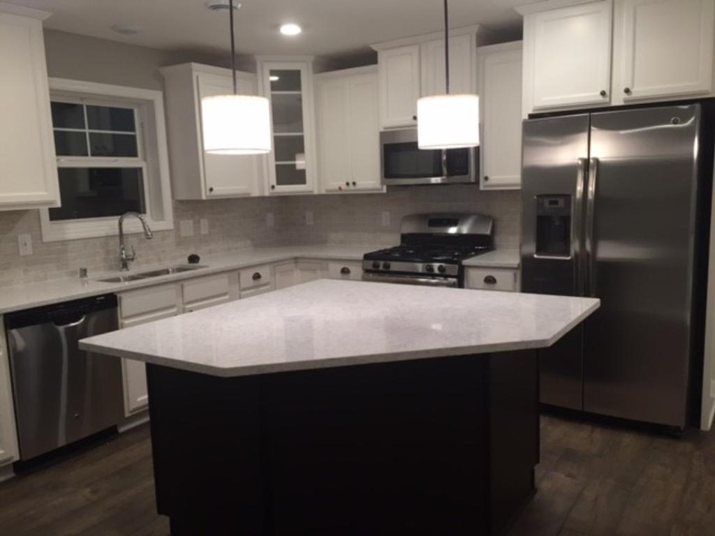 Oversized kitchen island with lots of cabinet space!
