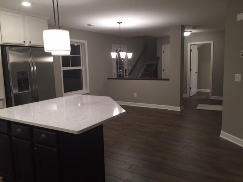Large eat in kitchen with center island with room for 4 breakfast counter stools