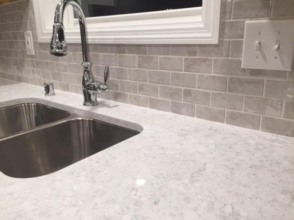 Stratus white quartz kitchen counters with beautiful coordinating subway backsplash