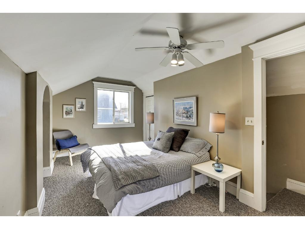 Upper level master suite is flooded by natural light from the huge South facing window overlooking that side lot which could be your fantastic garden.  Heck, you could plant an orchard out there!