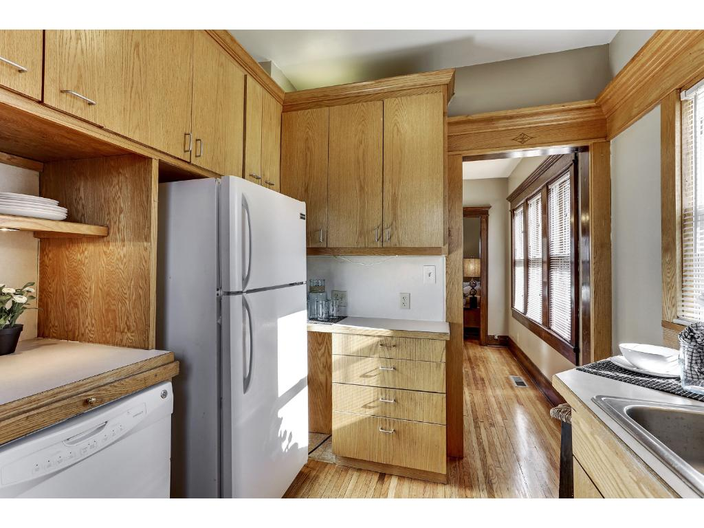 Another view of kitchen showing abundance of cabinets with modern flat panel doors.