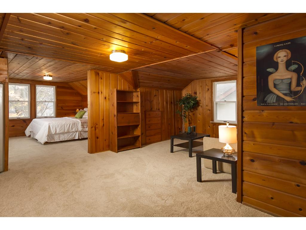 Spacious upper level, with bedroom, office area and living space.  Newer windows and new carpet.
