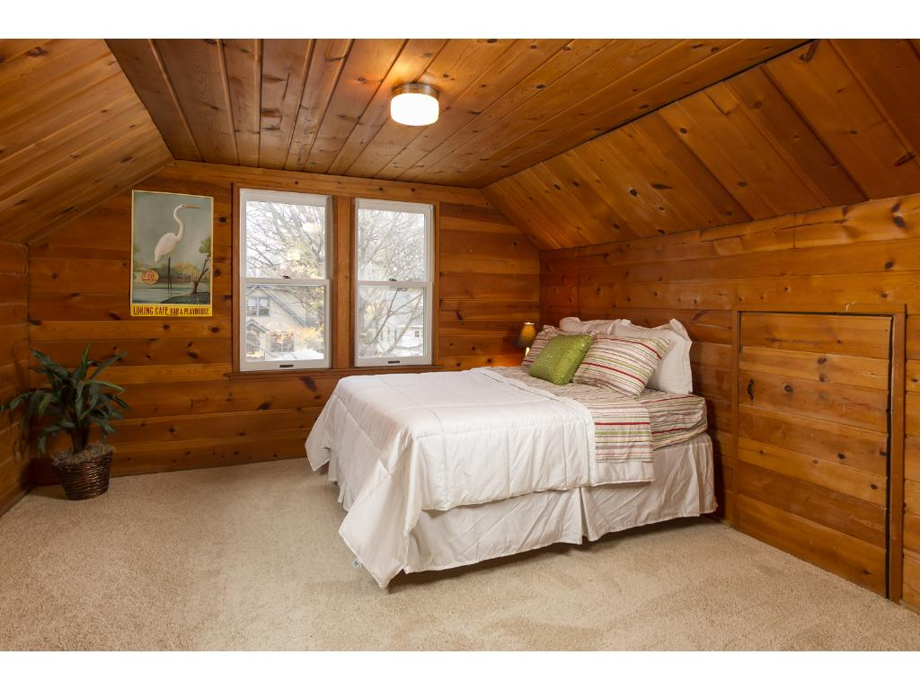 Upper level bedroom with new carpet and great ceiling height.