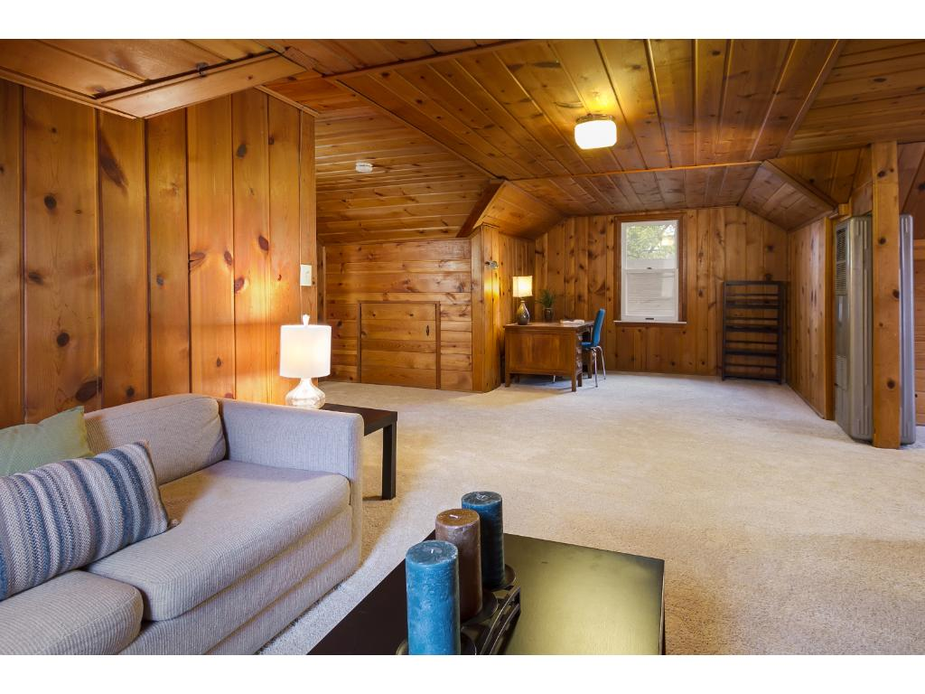 Upper level with room enough for office and living area.  New carpet and newer windows.