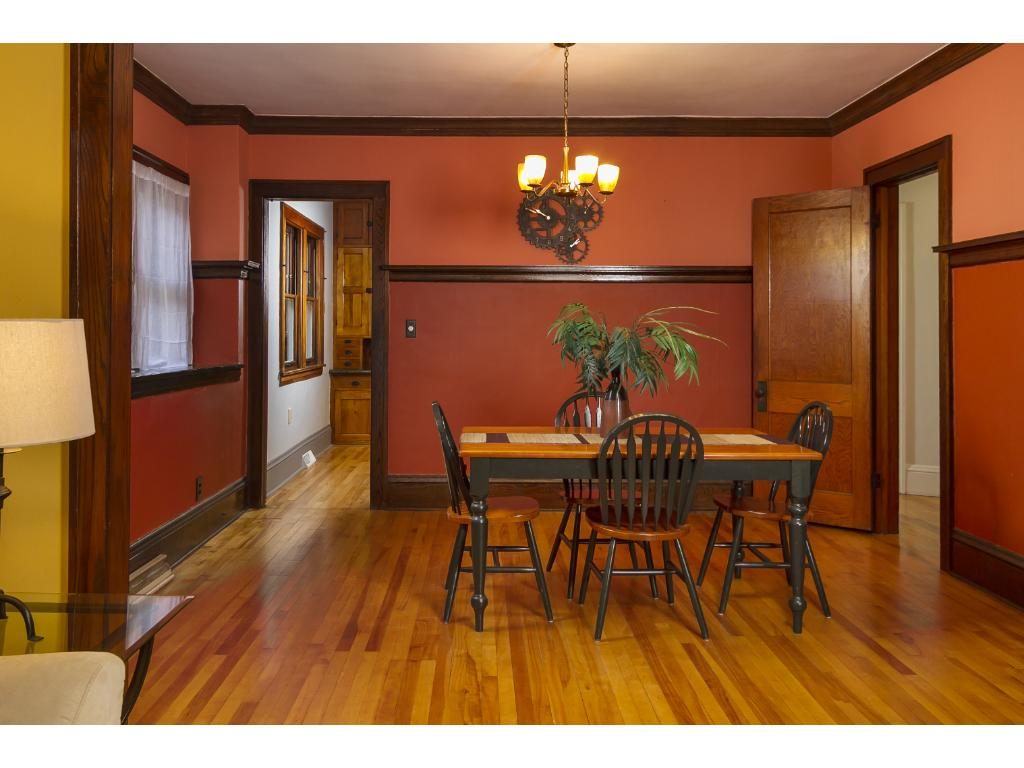 Craftsman inspired details including original picture rail in dining room.