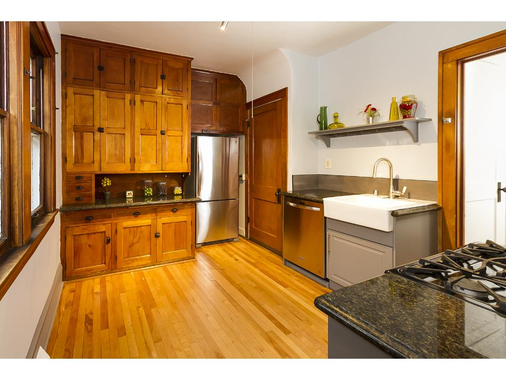 Updated kitchen with new stainless appliances, granite, new farmhouse sink and cabinets.