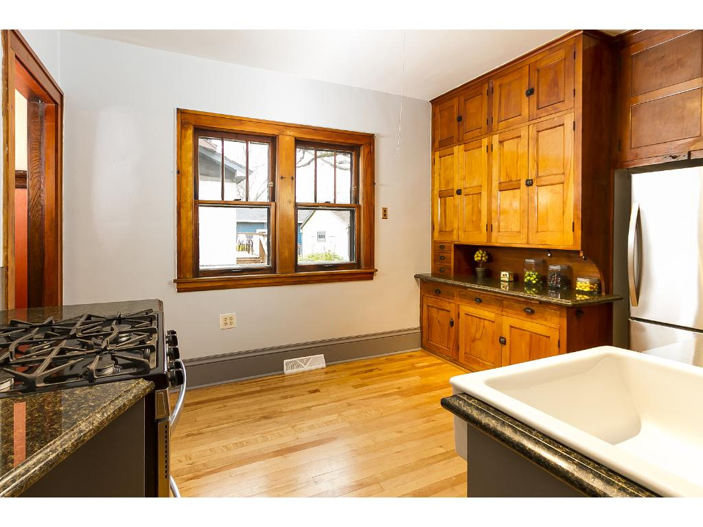 Original built-in cabinet preserved and updated with granite countertop.