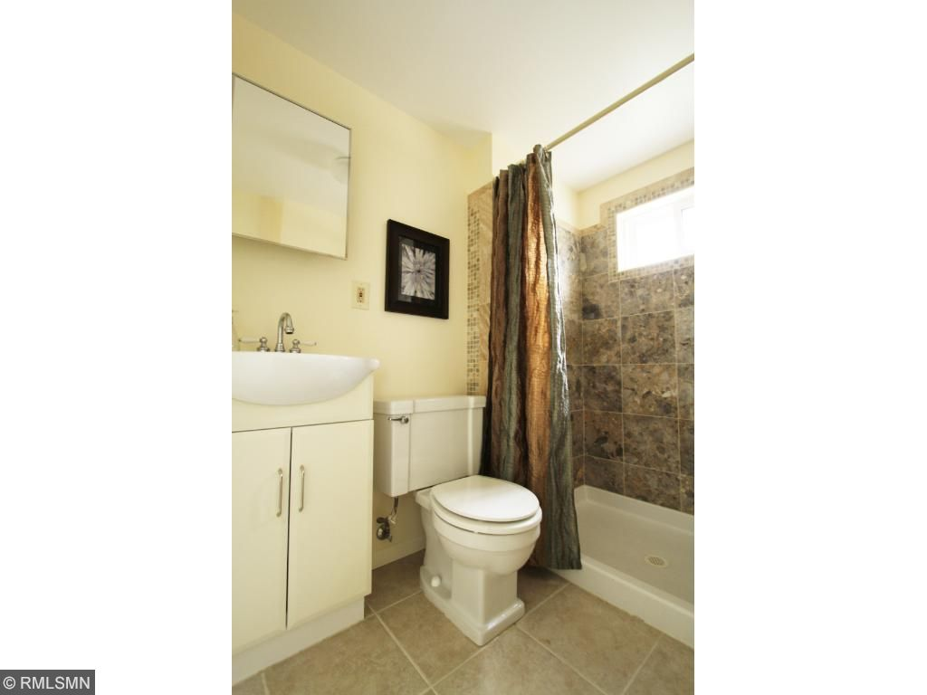 Upper level bath is completely remodeled. Can you imagine yourself here?