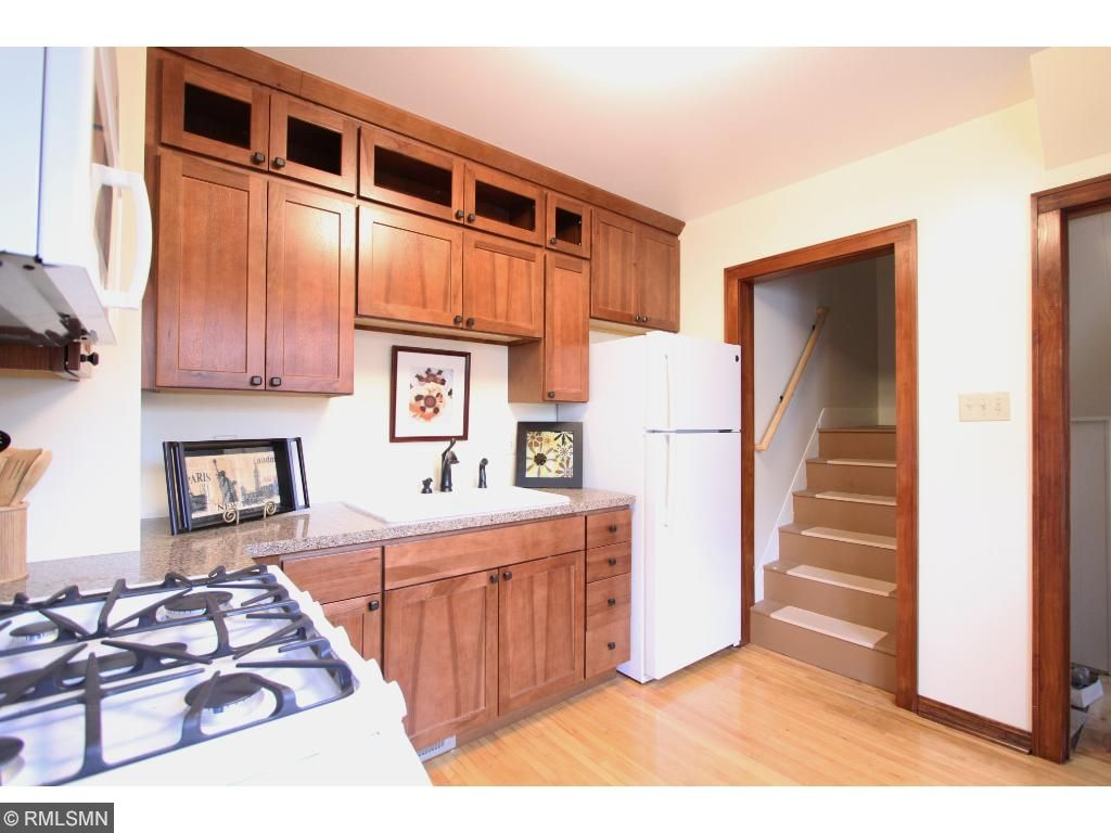 New kitchen has custom cabinets, new appliances and room for a table. Stairway leads to the lovely 2nd floor getaway!