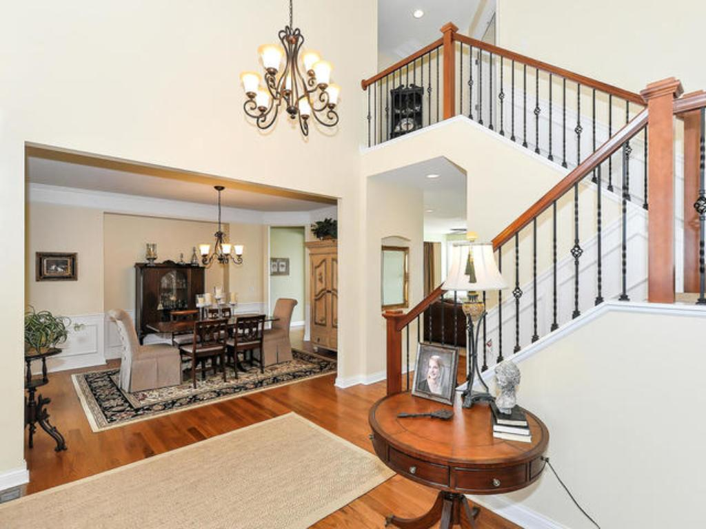 TWO STORY FOYER W/GRACIOUS OPEN STAIRCASE