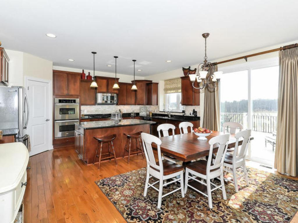 CENTER ISLAND KITCHEN WITH GRANITE AND STAINLESS STEEL APPLIANCES