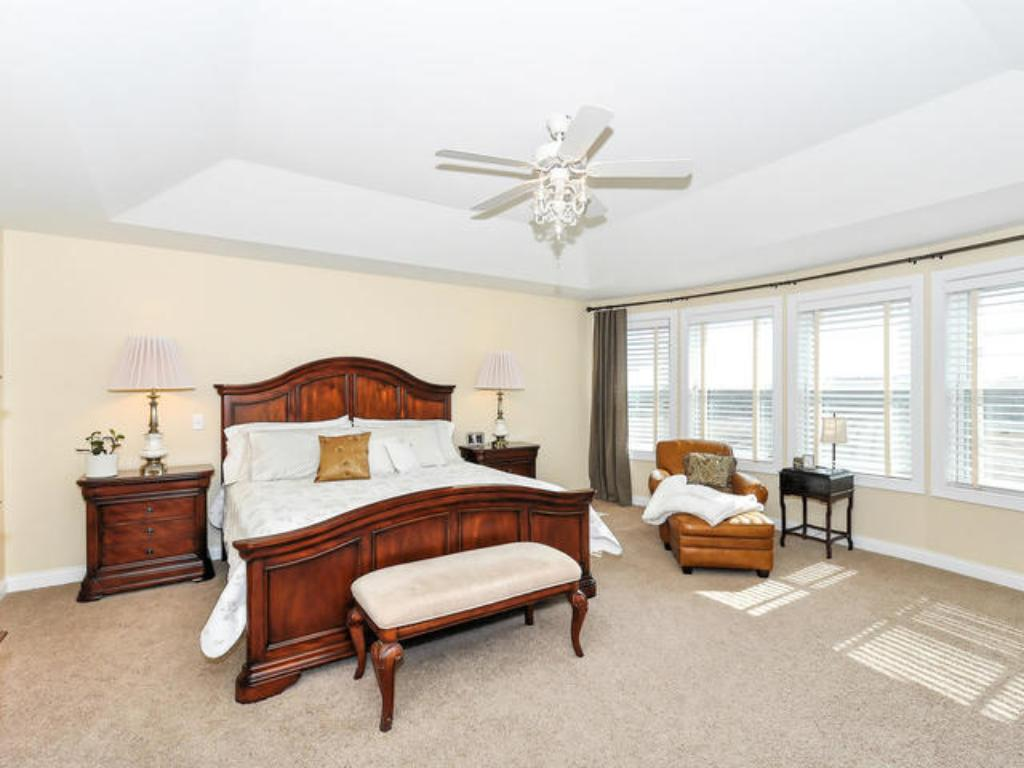MASTER SUITE WITH PRIVATE BATH OFFERING SEPARATE TUB & SHOWER
