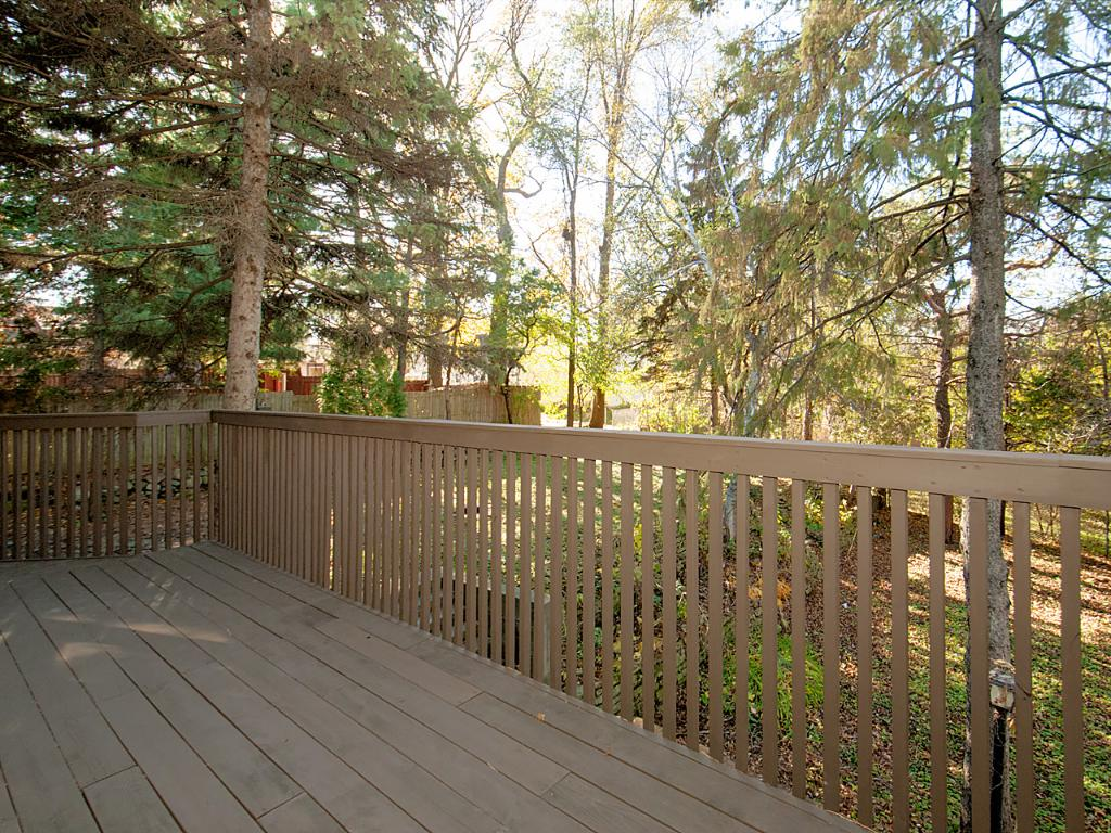 Large deck to enjoy morning coffee or evening sunsets. Also a great lookout over the huge backyard.