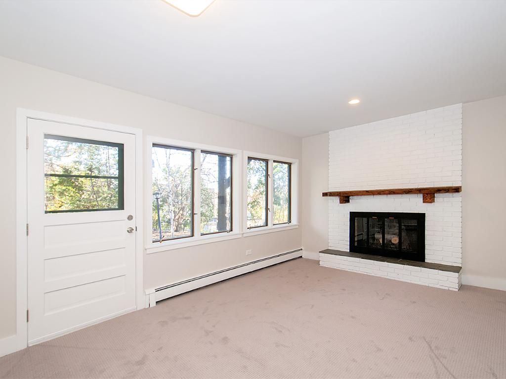 Wood burning fireplace in the basement walk-out family room.