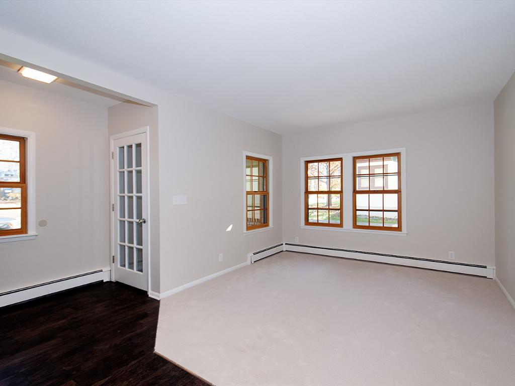 Front entry of the home walks into a living room with lots of space to remove shoes and have a coat rack.