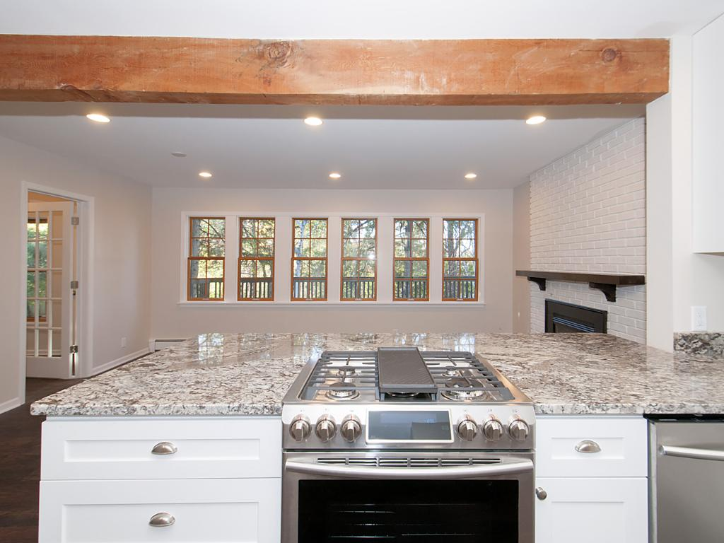 Amazing kitchen with HUGE granite counter top with overhang for breakfast bar.