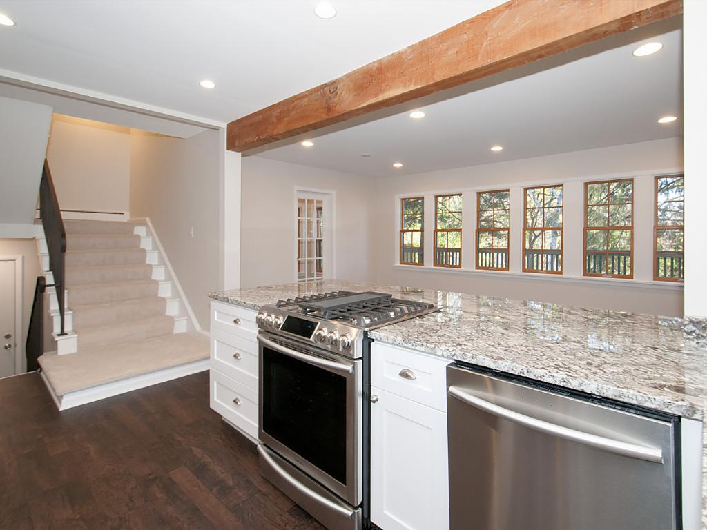 Beautiful Samsung appliances. Cook while looking out to the semi-private backyard with lots of light.