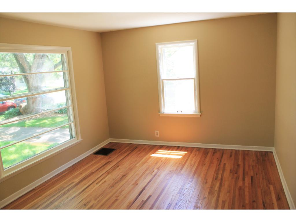 Living room with over sized window.