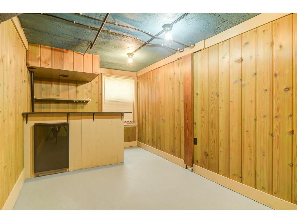Basement bonus room, bar area already set up - small fridge will stay with house.