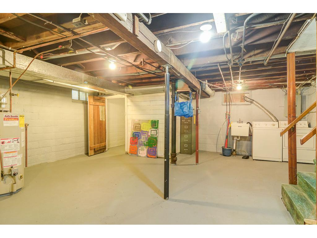 Basement is clean and is host to the laundry and has plenty of storage space.