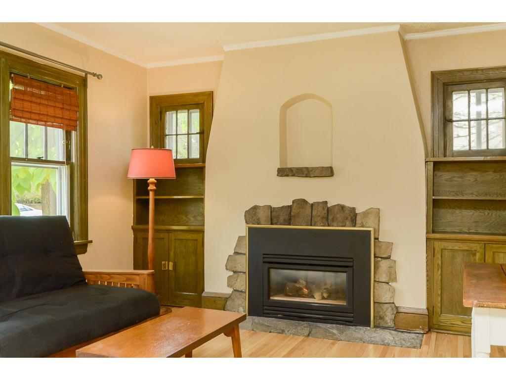 Built-ins showcase the fireplace.