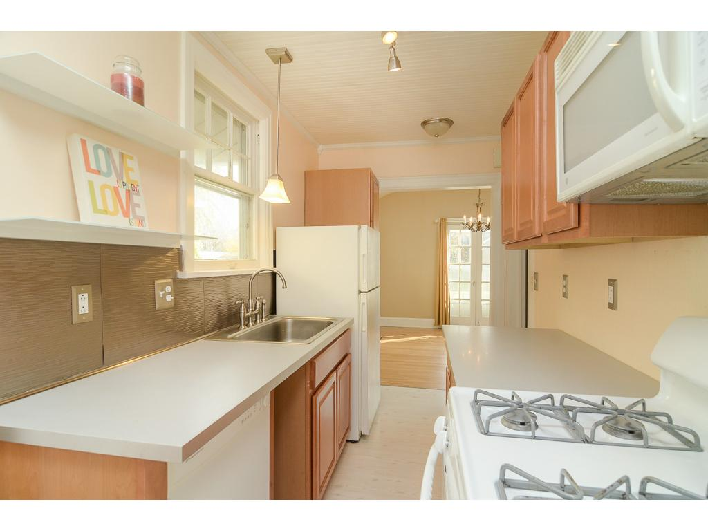 Kitchen has ample cabinet space and counter space.