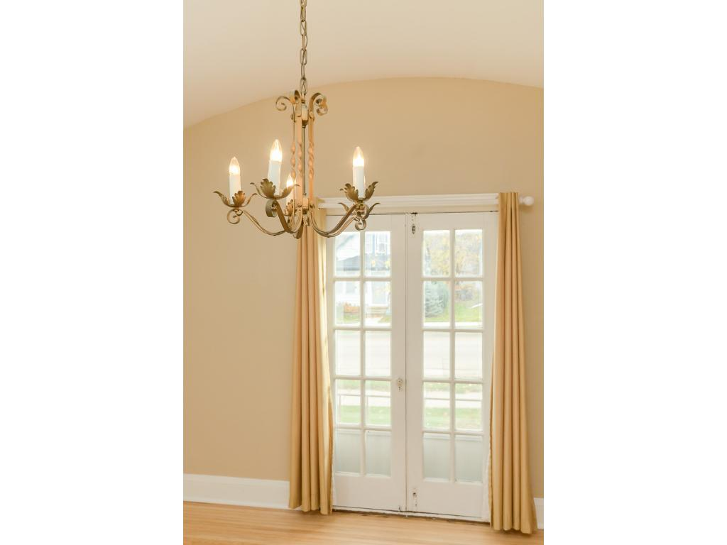 Another view at the arched dining room, this also shows the lovely french doors.