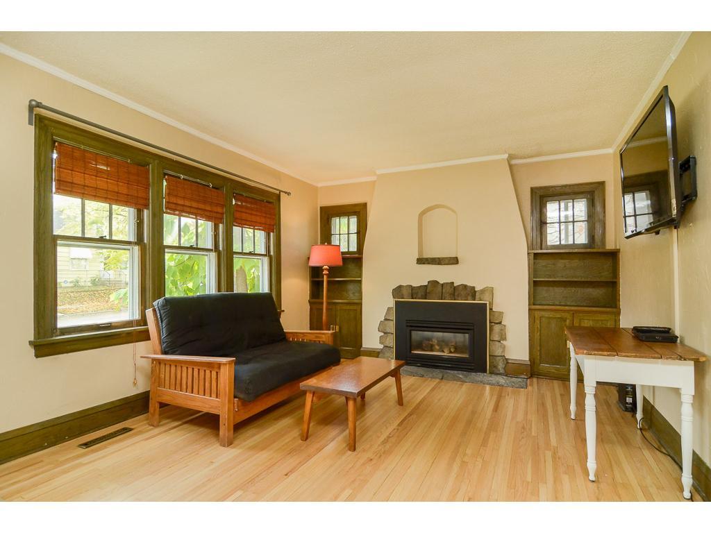 Living room has hardwood floors and nice amount of windows.