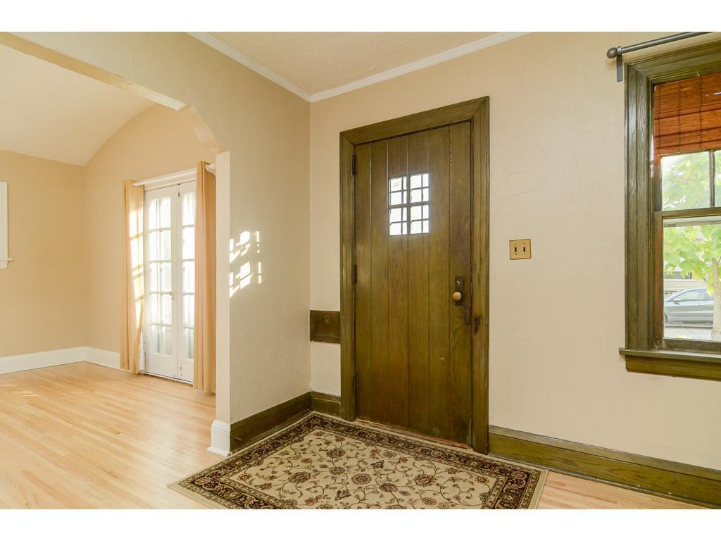 Front door is believed to be original, solid wood.