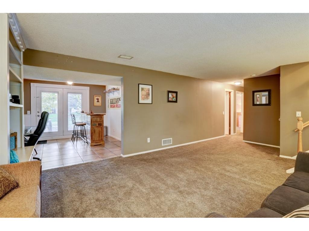 The walkout area features tile floors and can be used as a mud room, a computer area, or a bar! Your choice!