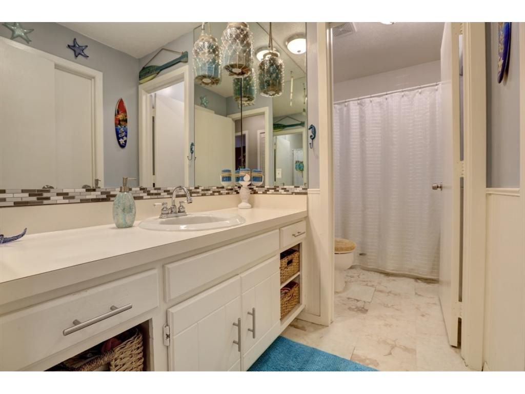 "Main level ""master-walk-through"" bath is well updated..."
