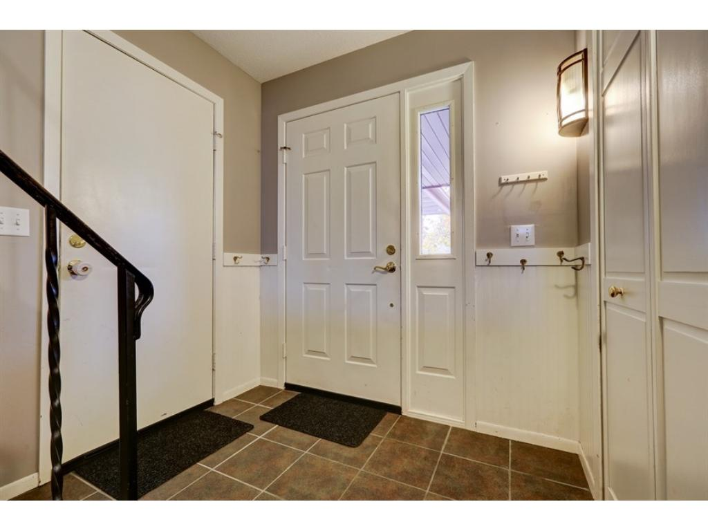 Large entry with tile floors, convenient coat/key hooks, closet and garage access.