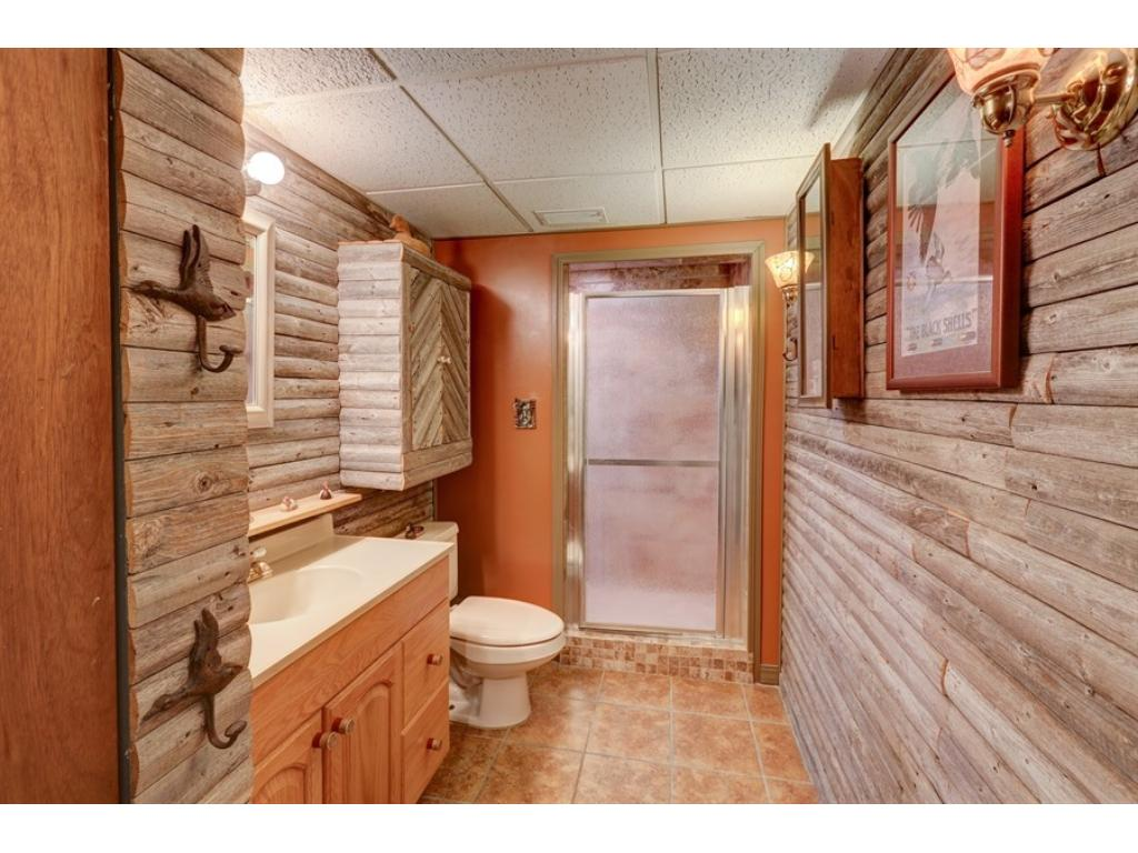 Custom designed LL bath has a great North woods feel and comes equipped with tile floors and shower.