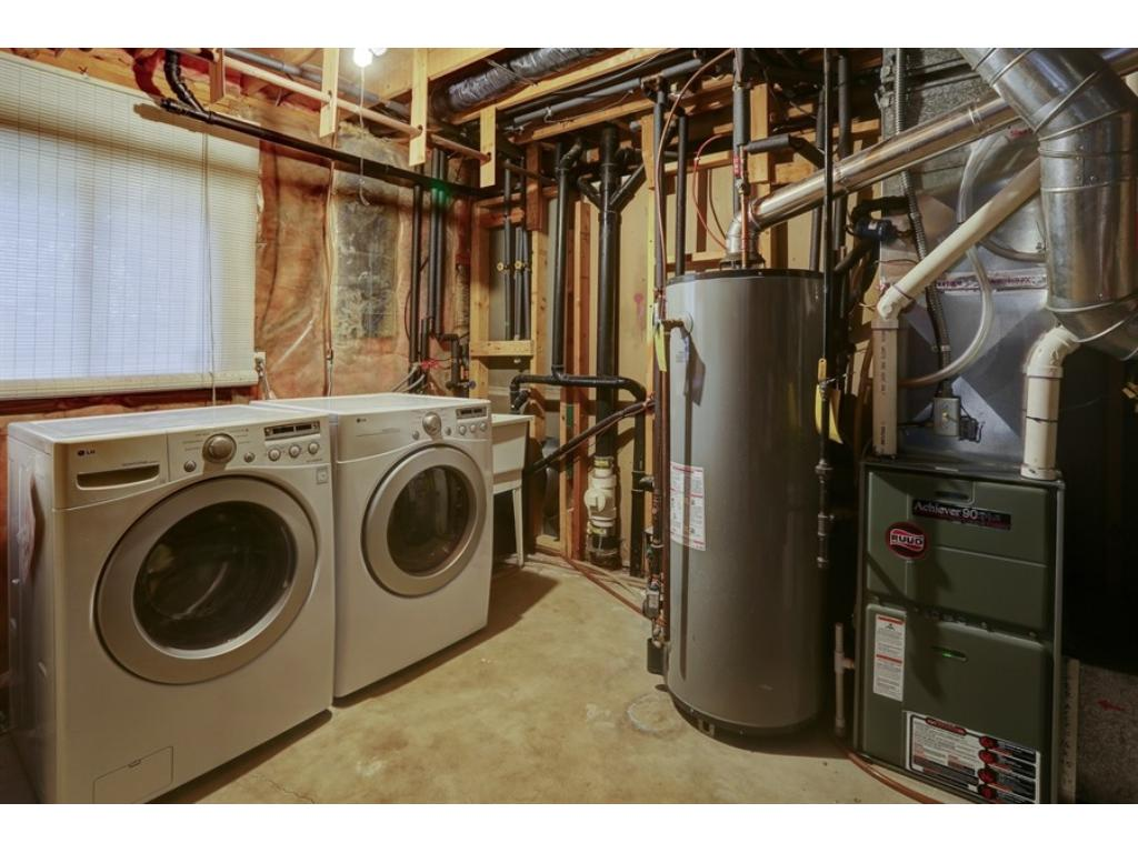 The high-efficiency furnace and AC were new in 2009, and the washer and dryer stay with the home.