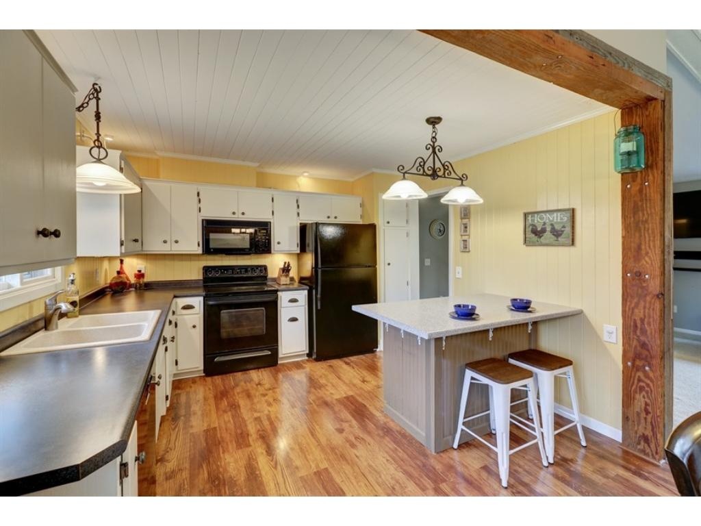 Well updated kitchen with island, laminate floors, updated lighting and appliances.