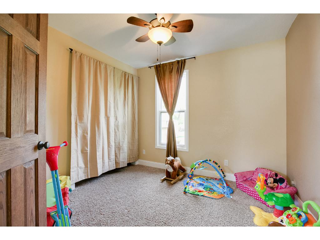 3rd BR on main floor currently used as playroom & den.