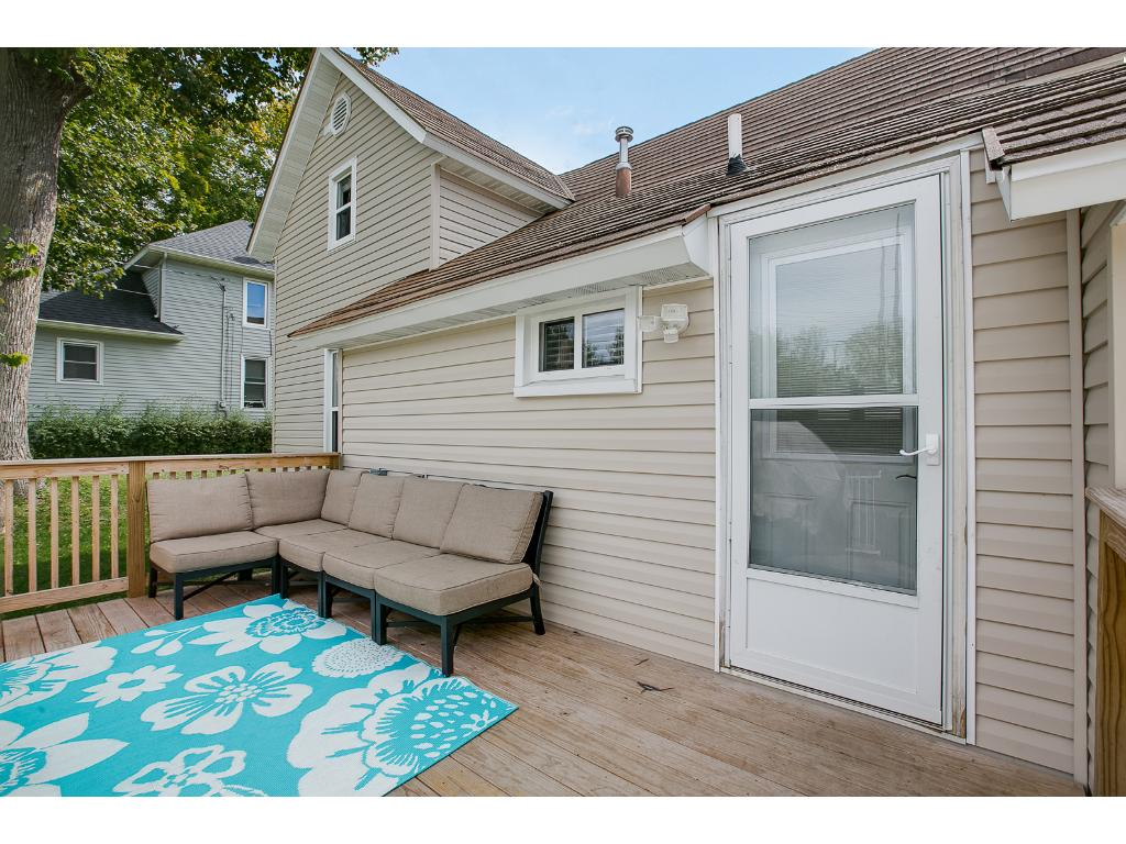 Great back deck overlooking almost 1/2 acre back yard with plenty of room for outdoor dining.