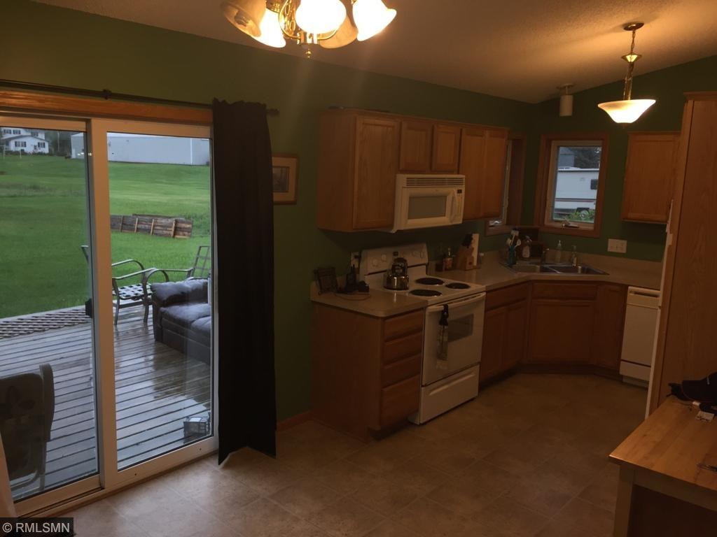 Kitchen with kitchen window. Dining/walkout.